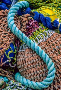 curve of rope on pile of nets