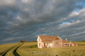 Storm clouds behind old house south of Pullman on Whitman Road in the Palouse